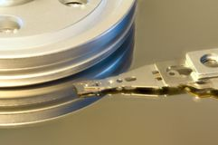 Inside old mechanical hard drive with read/write head. royalty free stock photo