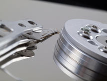 Hard Drive platter and head on right side Stock Image