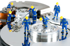 Hard Drive repair concept. Group of workers repairing HDD. Hard Drive repair concept Royalty Free Stock Photo