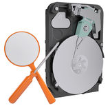Hard drive, screwdriver and magnifying glass Royalty Free Stock Image