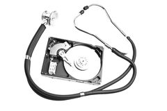 Hard drive and a stethoscope Royalty Free Stock Image