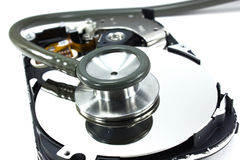 Hard drive and a stethoscope Royalty Free Stock Images