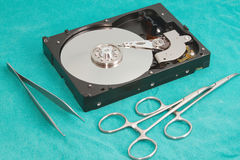 Hard drive with surgery tool Stock Photography