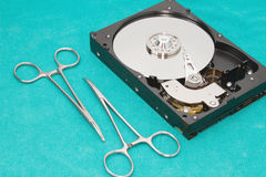 Hard drive with surgery tool Royalty Free Stock Photo