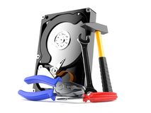 Hard drive with work tools. On white background Royalty Free Stock Image