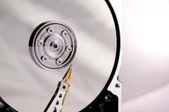 Hard drives needle and platter in the case royalty free stock image
