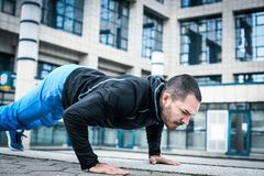 Hard exercise for body. Sporty man. Sporty young man working hard exercise for body. Close up Royalty Free Stock Images