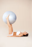 Hard exercises with rubber ball Royalty Free Stock Photos