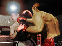 Hard fight. Two boxers  fighting under the lights. One of them receives a hard punch which makes him lose his teeth protector Stock Photos