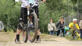 Hard finish for BMX bicycle challenge competitor comes first. Stock footage stock footage
