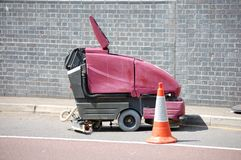 Hard floor cleaning machine. Surrounded by safety cones Stock Images
