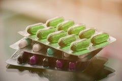 Hard gelatin capsule and soft gelatin capsule in strips stock photo
