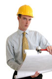 Hard Hat. A construction foreman in a hardhat holding blueprints Royalty Free Stock Photography