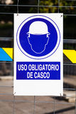 Hard hat area, with text in spanish. Stock Photos