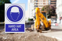 Hard hat area, with works zone background. Royalty Free Stock Photos