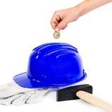 Hard hat as piggy bank Stock Photos