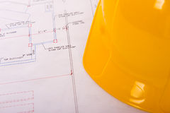 Hard Hat and Blueprints royalty free stock image