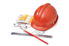 Hard hat with blueprints Stock Photo