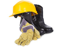 Hard hat, boots and gloves Stock Photos