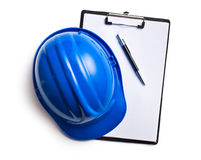 Hard hat with clipboard Stock Photography