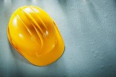 Hard hat on concrete background Royalty Free Stock Photo