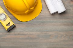 Hard hat construction plans. Construction building building helmet close-up collection construction drawings stock photography