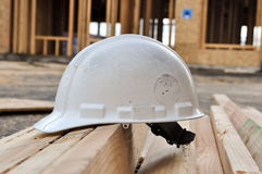 Hard Hat at Construction Site Stock Image