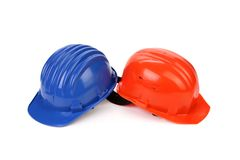 Hard hat of different colors like yin and yang. Stock Photos