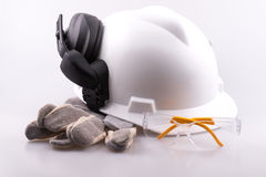Hard hat, ear defenders, gloves and safety glasses Royalty Free Stock Images
