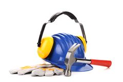 Hard hat and ear muffs hammer. Stock Photography