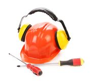 Hard hat ear muffs and screwdrivers. Stock Photography