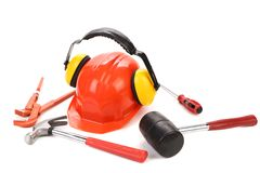Hard hat and ear muffs with tools Royalty Free Stock Images