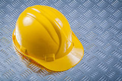 Hard hat on grooved metal plate construction concept Royalty Free Stock Image