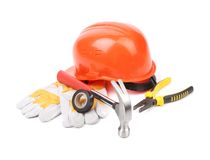 Hard hat, hammer, pliers and work gloves. Stock Photos