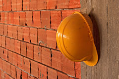 Hard hat hanging on concrete wall Royalty Free Stock Photo