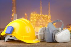 Hard hat helmet and gas respirator. With industrial backdrop Royalty Free Stock Photo