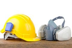 Hard hat helmet and gas respirator. On table Stock Photography