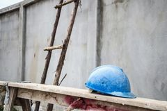 Hard hat on house building construction site Royalty Free Stock Images
