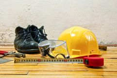 Hard hat, leather boots and goggles Royalty Free Stock Image