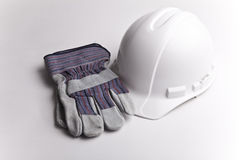 Hard hat leather gloves. Centered hard hat hardhat with leather gloves on white background room for text personal protective equipment Royalty Free Stock Image