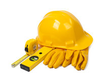 Hard hat, leather gloves and tools Stock Photo