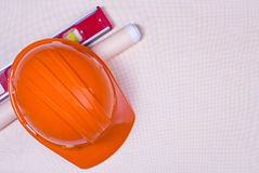 Hard hat, level tool and graph paper Stock Photo