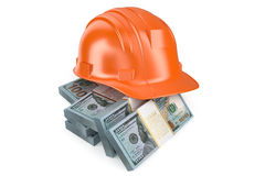 Hard hat with money Stock Image