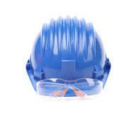 Hard hat with a pair of safety glasses. Royalty Free Stock Photography