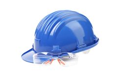 Hard hat with a pair of safety glasses. Royalty Free Stock Images