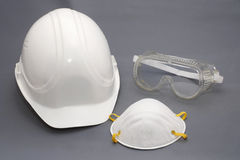 Hard hat and safety protection equipment. Protective hat and safety protection equipment in the construction industry (goggles and dust mask Stock Images