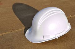 Hard Hat with Shadow. At New Home Construction Site Royalty Free Stock Images