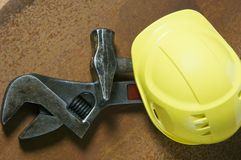 Hard-hat and tools. Symbolic of blue-color-work Royalty Free Stock Photos
