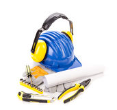 Hard hat with tools for architects. Royalty Free Stock Image