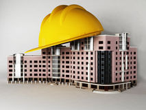 Hard hat on top of the building Stock Image